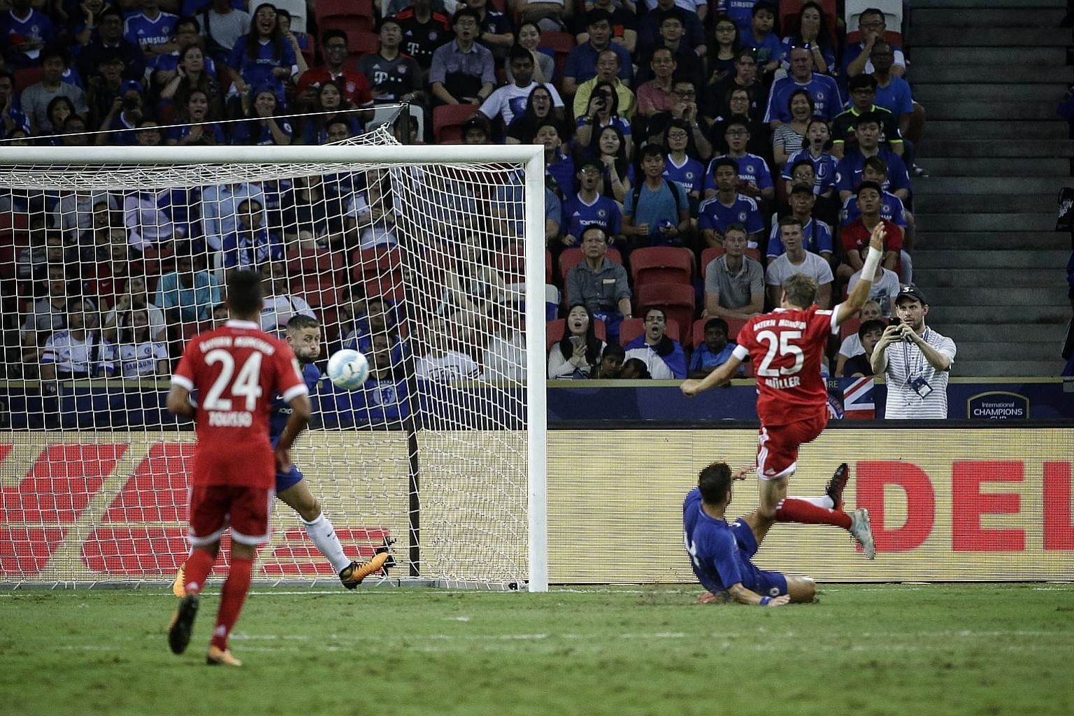 Bayern Munich forward Thomas Muller (jersey No. 25) slamming the ball home for his club's second goal in their 3-2 win over English Premier League champions Chelsea in the first match of the International Champions Cup at the National Stadium last ni