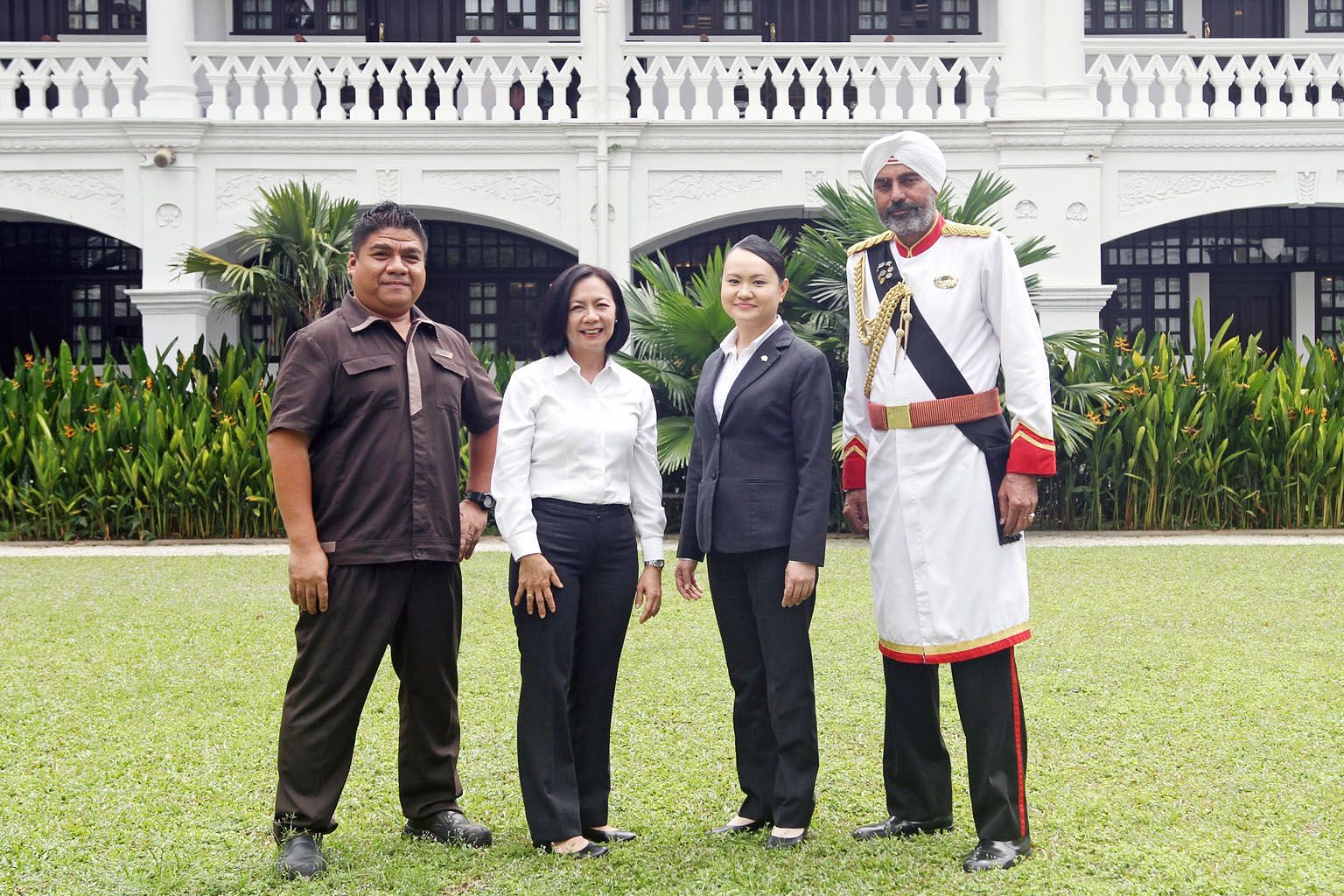 Among the many faces working to preserve the facade and hospitality of the colonial-era Raffles Hotel are (from left) Mr Samsol Misbah, assistant chief engineer; Madam Joey Chea, restaurant senior captain; Ms Serene Lim, food and beverage operations