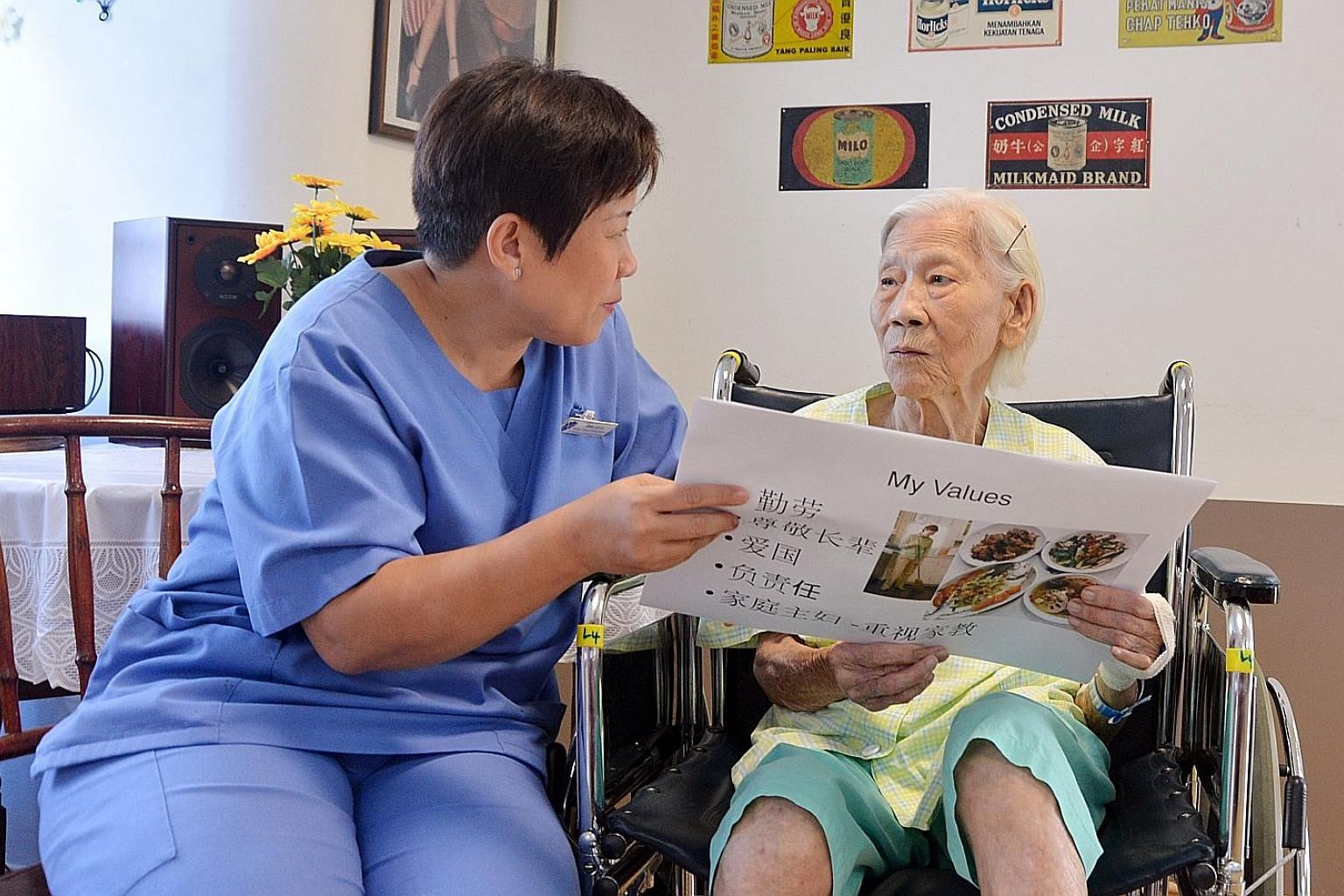 Madam Mary Ho, who has mild dementia, taking part in an activity to stimulate the brain with therapist Anna Lee at the St Andrew's Community Hospital. Madam Ho also attends Life story sessions at the hospital, where dementia patients share their stor