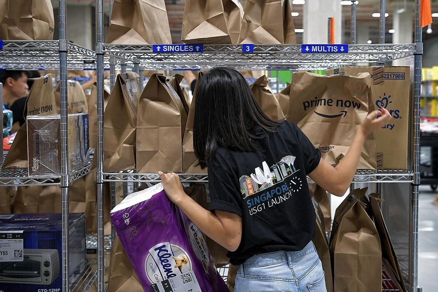 An Amazon employee packing orders. Some consumers could not place orders yesterday due to overwhelming demand.
