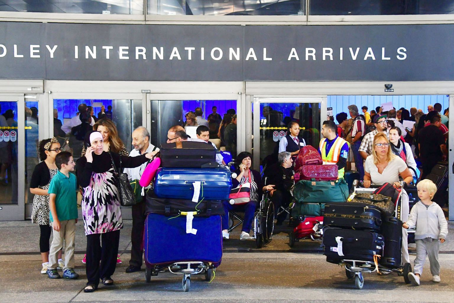 People leaving Los Angeles International Airport last month, where they were met by activists protesting against Mr Donald Trump's ban temporarily barring entry into the United States from Libya, Iran, Somalia, Sudan, Syria and Yemen.