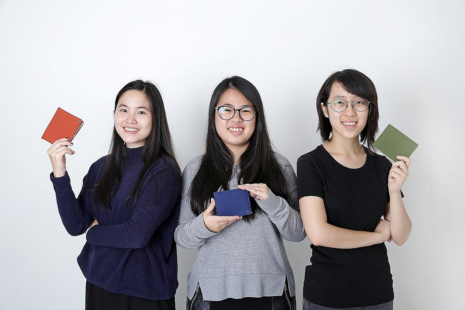 Last year, National University of Singapore industrial design students (from far left) Lim Li Xue, Ng Ai Ling and Cheryl Ho created a wallet called Kin, which separates coins and notes. Launched on crowdfunding platform Kickstarter, the design was a