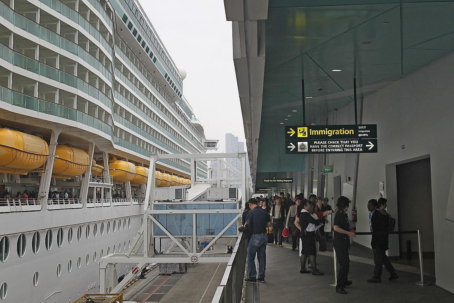 Travellers heading towards Immigration via a link bridge after disembarking from a Royal Caribbean cruise ship. Singapore has become a flourishing entry point for Indian cruise ship passengers, and to better accommodate guests from India, cruise oper