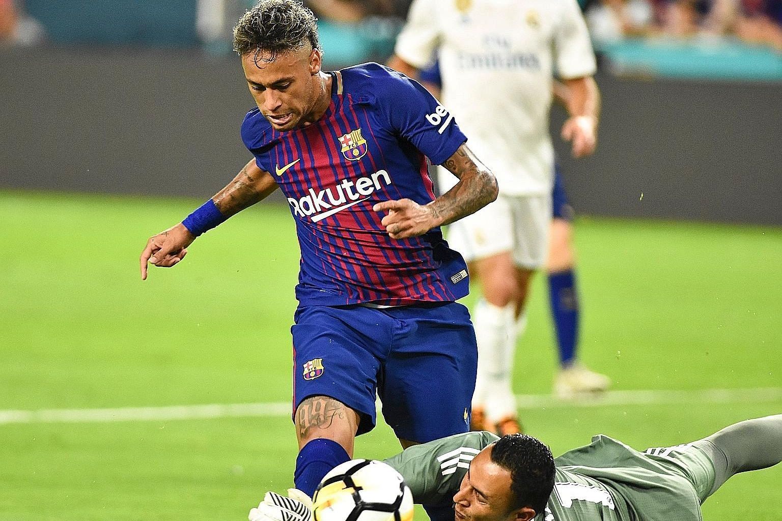 Barcelona's Neymar in action against Real Madrid goalkeeper Keylor Navas during a pre-season International Champions Cup match at the Hard Rock Stadium in Miami, Florida. The forward had agreed to a renewal bonus with Barcelona last year when he exte