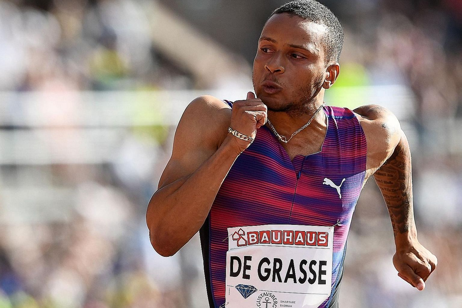 Andre de Grasse in action at the Stockholm Diamond League meet, where he set this year's fastest 100m time of 9.69 seconds.