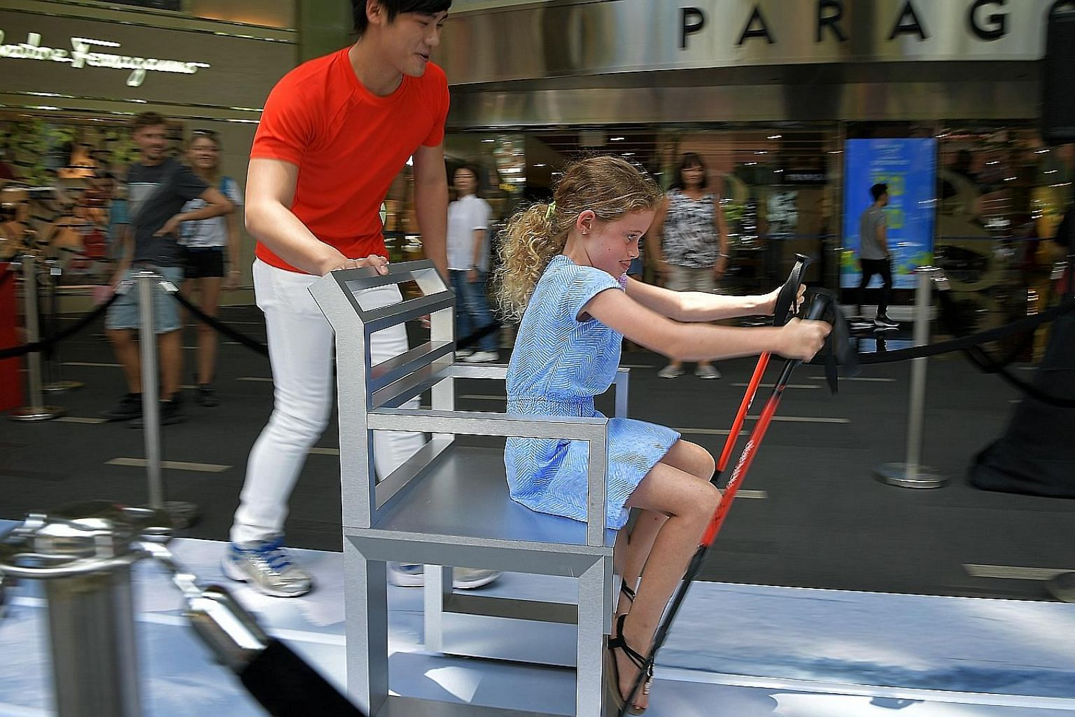 Eight-year-old Mili Reiter was among the adventurous shoppers who tried out the ski dash challenge, which involved gliding across a 12m ski track, at Paragon's main entrance yesterday. In collaboration with the Embassy of Switzerland and the Switzerl