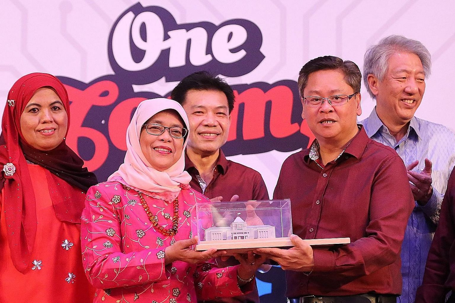 Speaker Halimah Yacob receiving a memento from Mr Tan Richard, general secretary of the United Workers of Electronics and Electrical Industries. With them are (from left) UWEEI executive council member Zahra Hadir, second assistant general secretary