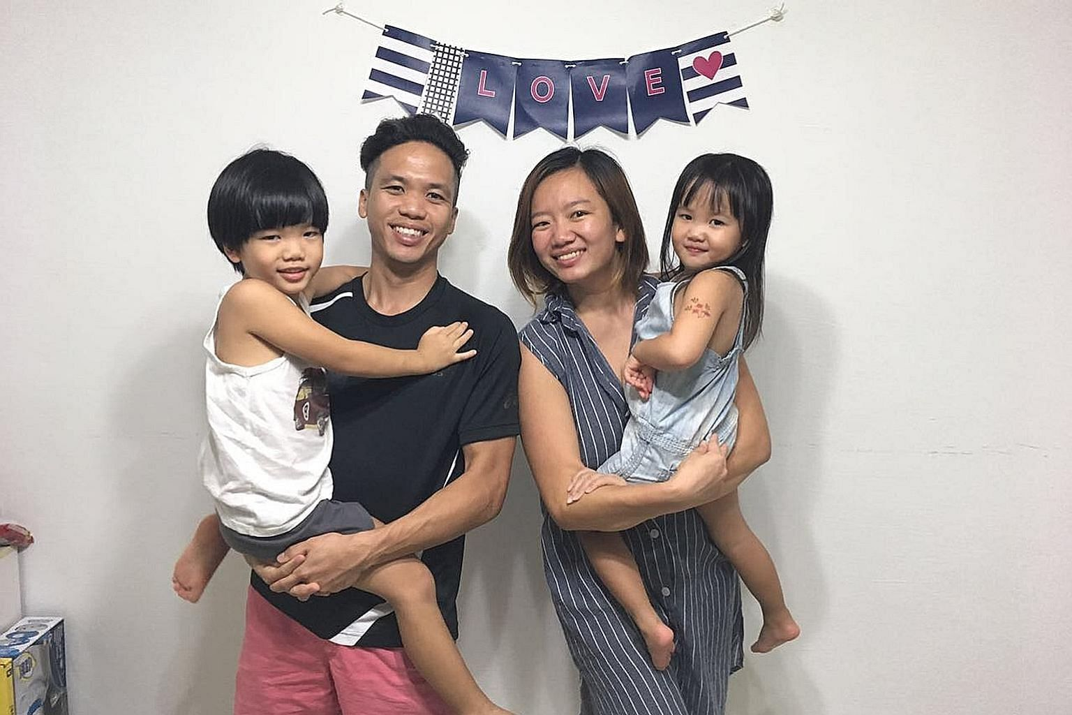 Mrs Rachel Fong with her husband Fong Xiongkun and their children (from far left) Victoria, Mark and Micah. Mr Kenny Leong, his wife Sophia Leong, son Emmanuel and daughter Elissa believe in apologising to one another after a conflict.