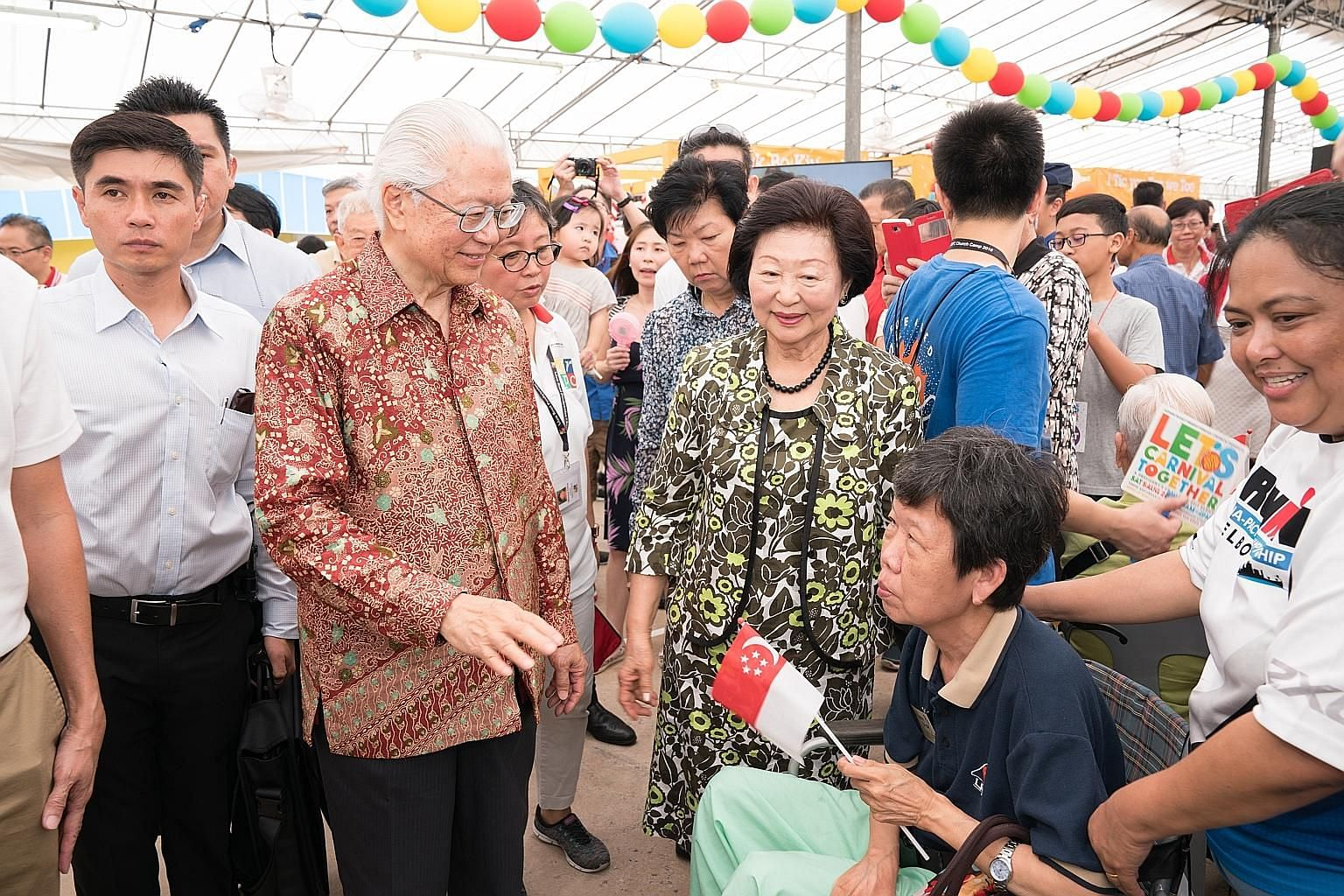 President Tony Tan Keng Yam and his wife Mary joined 700 beneficiaries at the carnival organised by Adam Road Presbyterian Church yesterday.