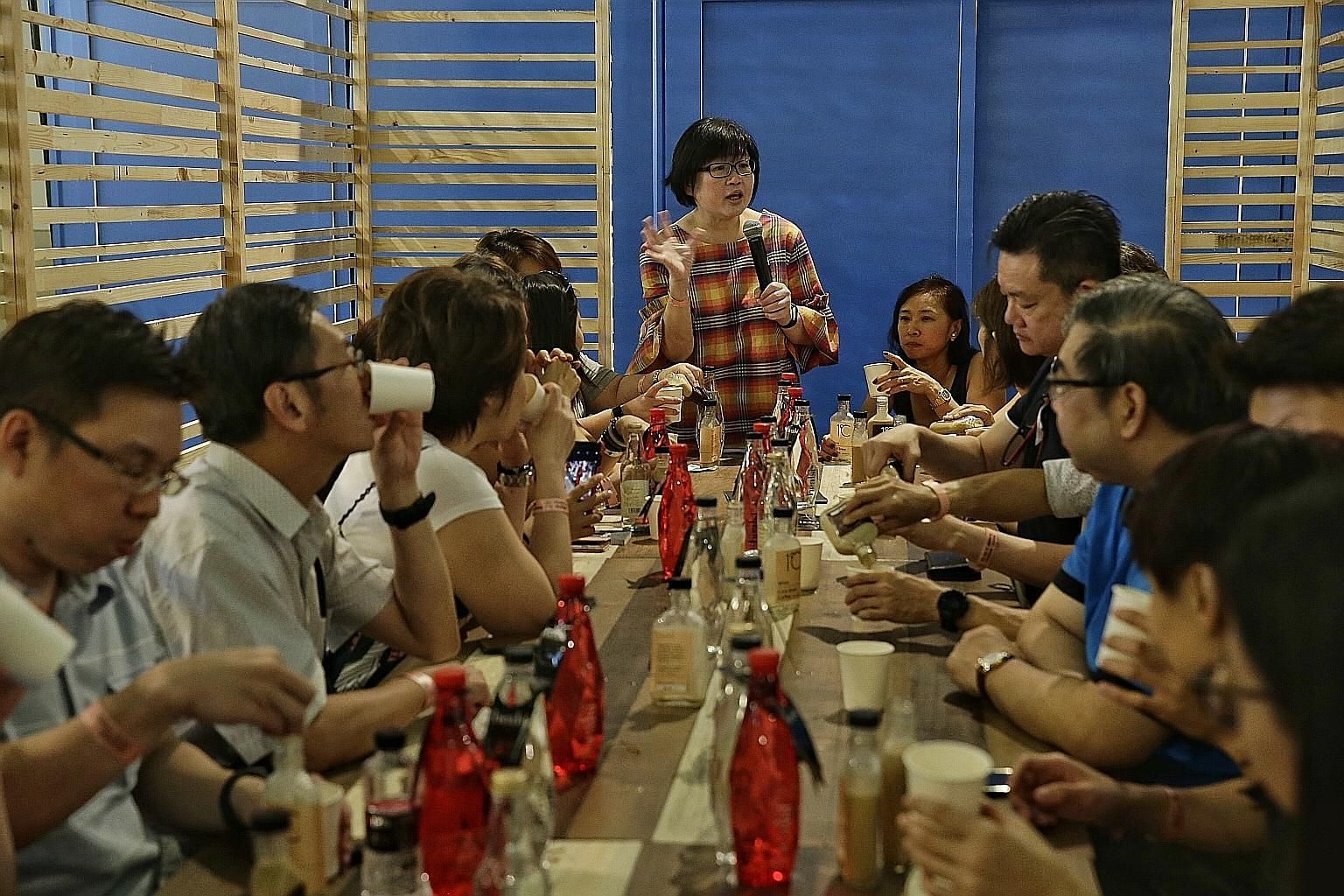 Above: Straits Times Life editor and veteran food writer Tan Hsueh Yun hosting dining session Posh Nosh: An Omakase Experience for a sold-out crowd of 24 diners yesterday at this year's Coffee Festival. Below: The Coffee Academics' coffee in a cone i