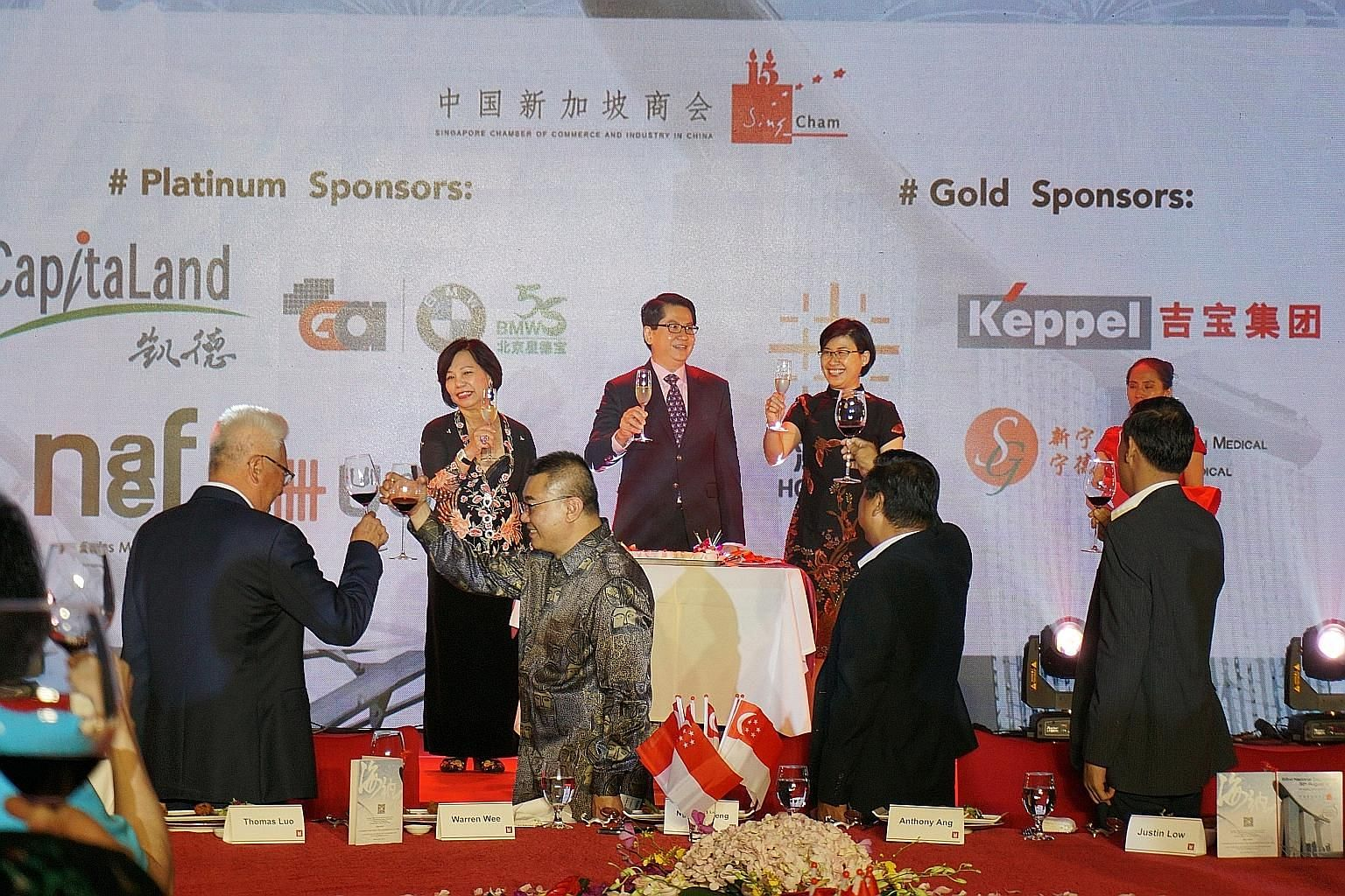 Right: At the dinner were Singapore's Ambassador to China Stanley Loh (centre), SingCham chairman Dorothy Seet (left) and Mrs Loh. Ms Seet (top) and Ms Edith Cheong (above) helped set up SingCham.