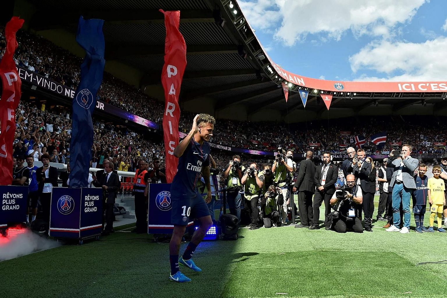 World-record signing Neymar waving to the adoring Paris Saint-Germain fans as he was presented at Parc des Princes ahead of PSG's Ligue One opener against Amiens.
