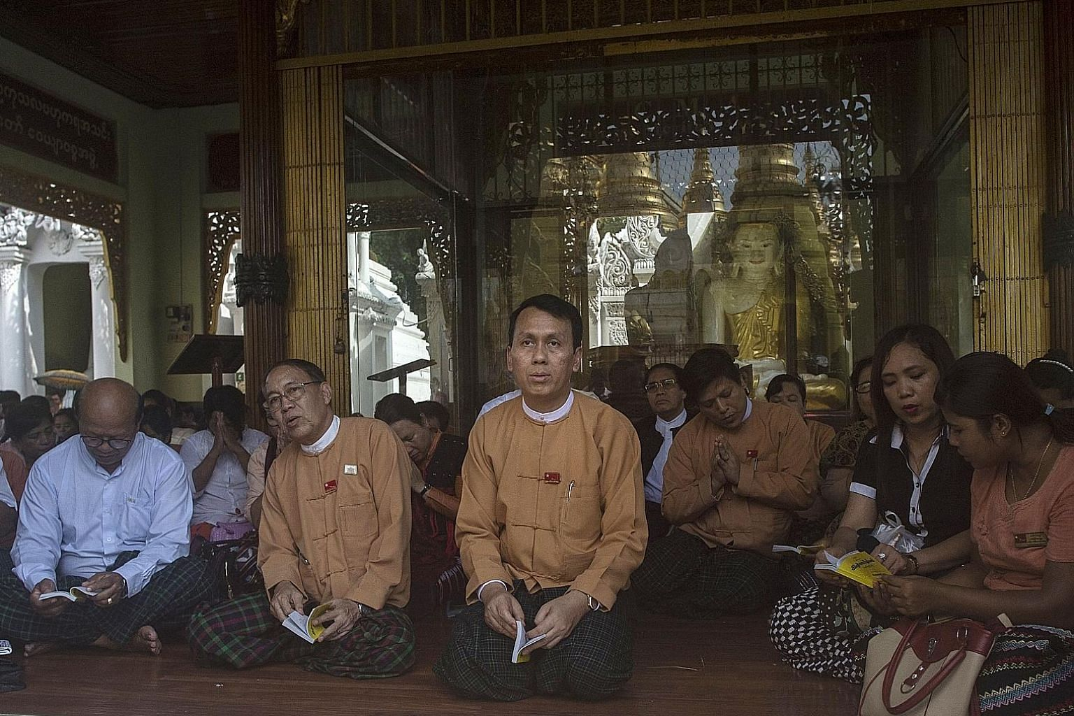 This photo, taken on May 18, shows Yangon Chief Minister Phyo Min Thein (centre) attending prayers for the recovery of the National League for Democracy party's patron Tin Oo at the Shwedagon Pagoda in Yangon. There was no public tender or debate in