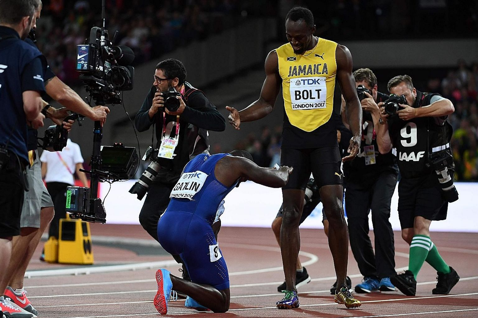 Justin Gatlin bowing down in respect to Usain Bolt, after his upset 100m win.