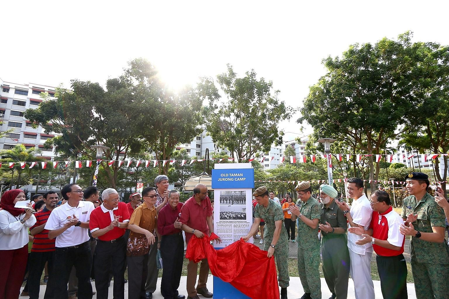 Deputy Prime Minister Tharman Shanmugaratnam unveiling the marker yesterday during the Taman Jurong National Day Observance Ceremony. He said the marker would be a way to remember the stories of duty, sacrifice and friendship that the pioneer NSmen h