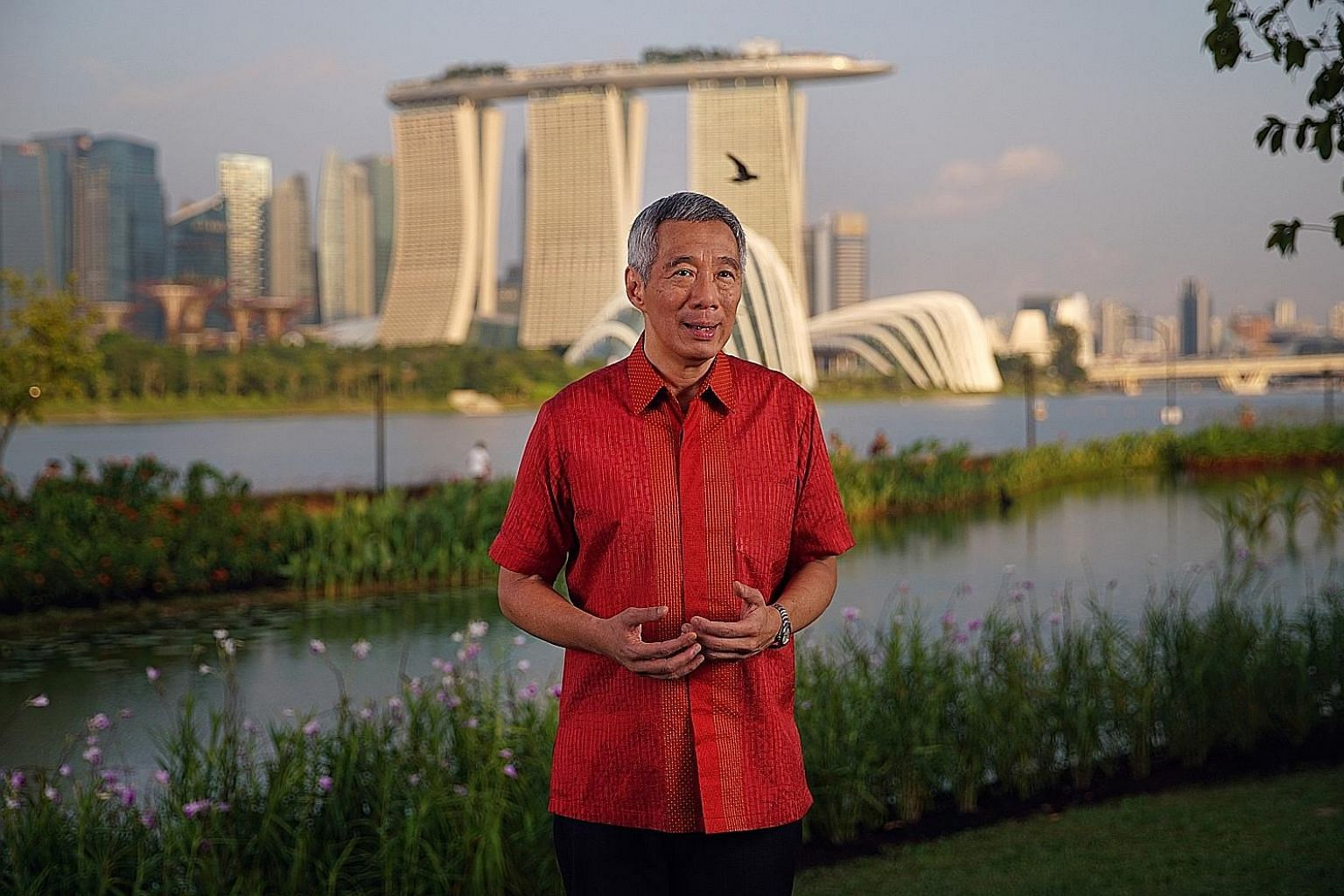 """Prime Minister Lee Hsien Loong delivering his National Day Message at Bay East Garden. He said that siting the Founders' Memorial there would allow Singaporeans to """"remember the values of our founding leaders, see what they have built and commit ours"""