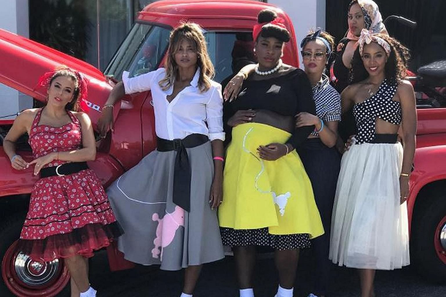 Tennis star Serena Williams' pregnancy playbook included throwing a baby shower last weekend, where the theme was a smashing retro return to the 1950s, including poodle skirts. Having a ball in this picture are (from far left) actress Eva Longoria, s