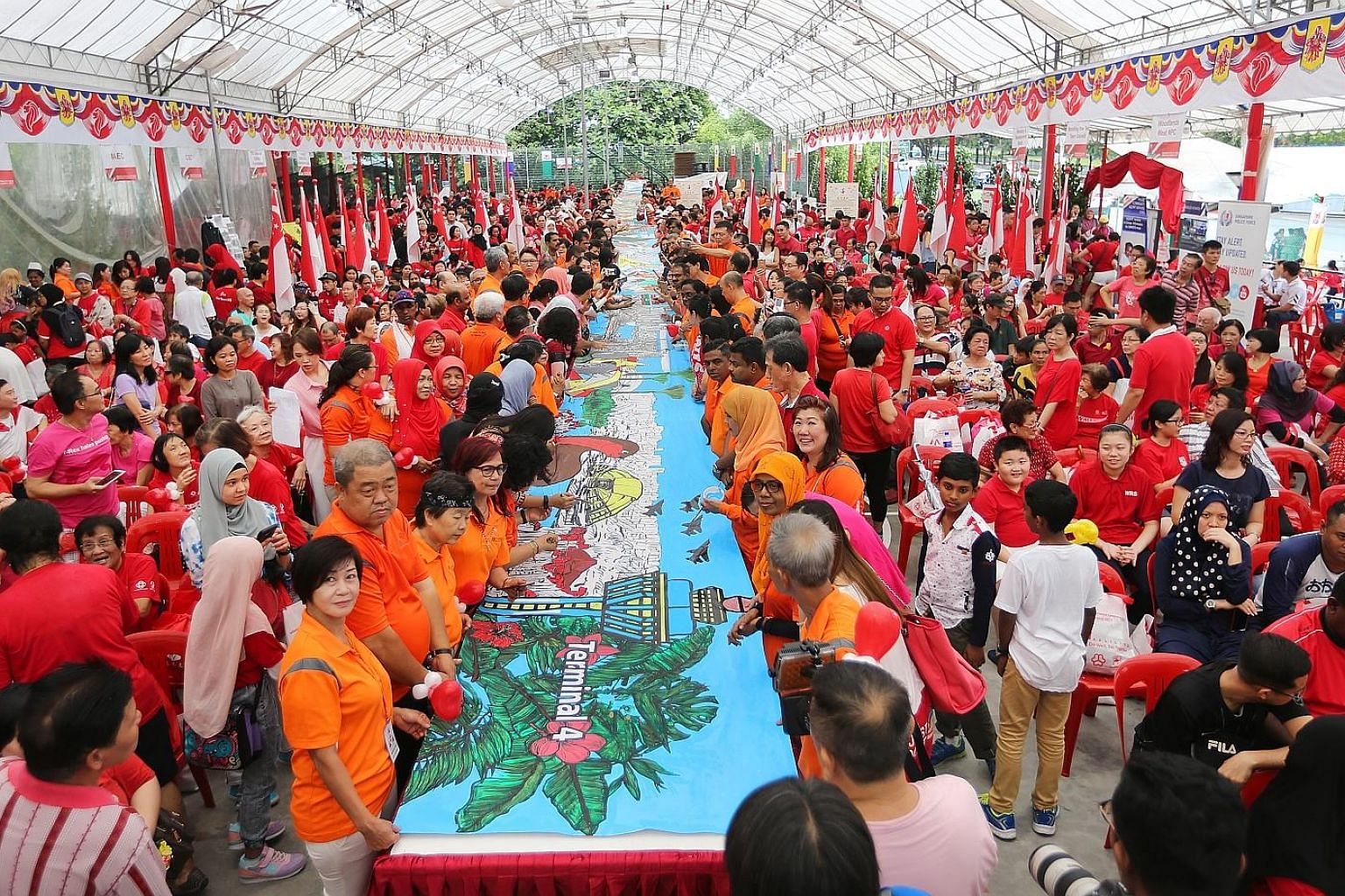 Marsiling residents yesterday unveiled a record-setting, 52m-long banner painting that charts Singapore's development from independence in 1965 till today.