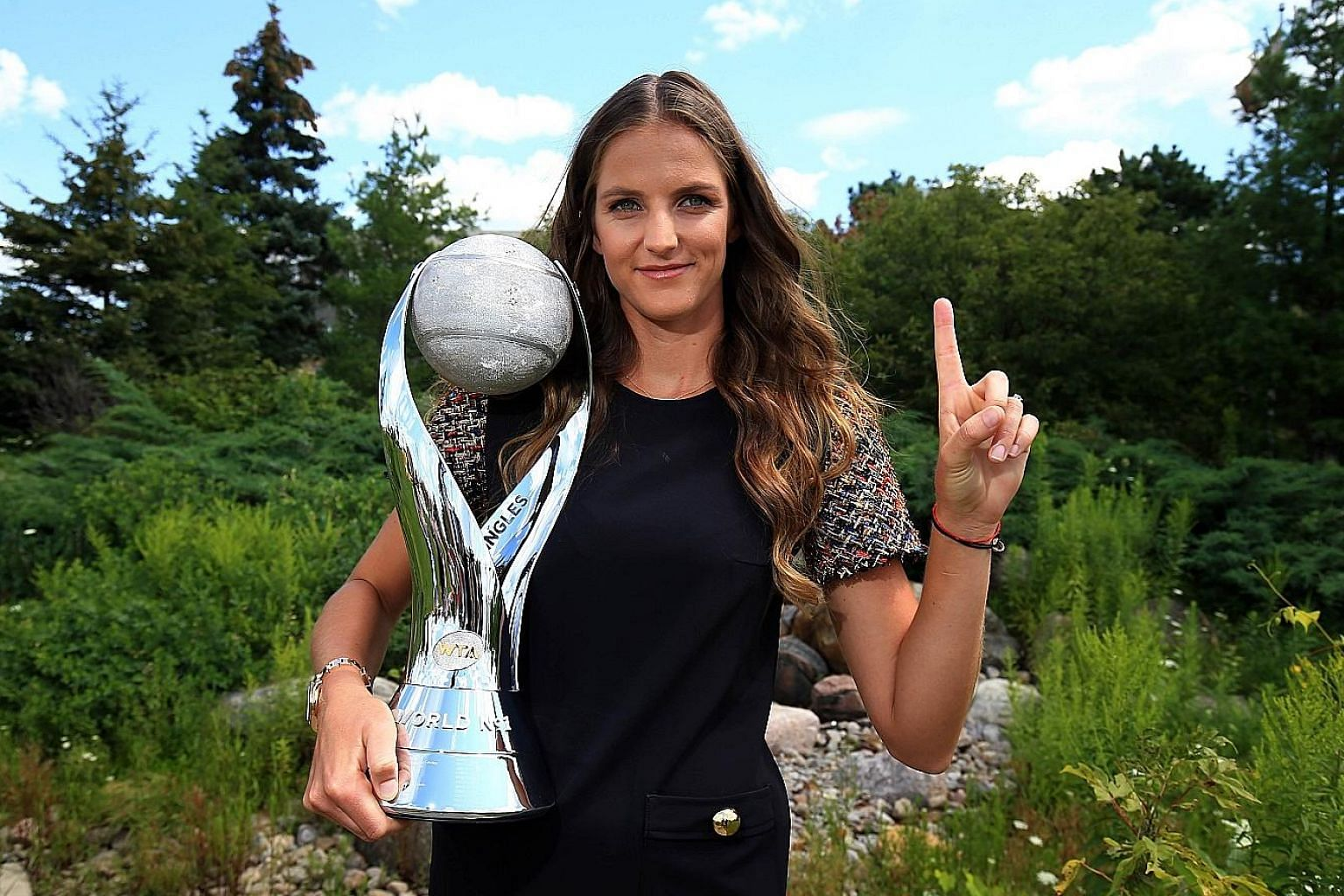 Karolina Pliskova of the Czech Republic with the WTA world No. 1 trophy in Toronto last Sunday. The Rogers Cup will be her first appearance on court since her elevation last month to the top spot, despite never having won a Grand Slam tournament.