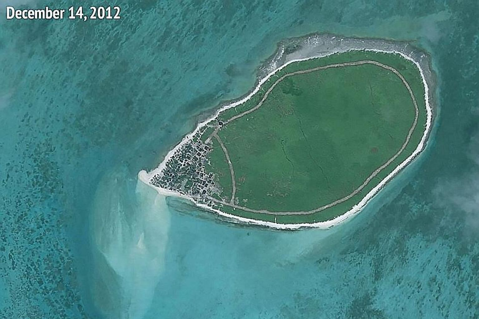 Satellite pictures released by a think-tank showing the new structures that were added to Tree Island between 2012 and this year.