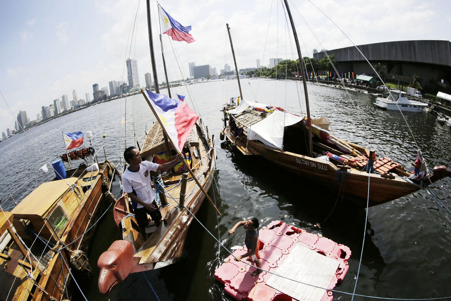 Filipino boats anchored near the venue of the recent Asean Foreign Ministers' Meeting in Manila. While many Asean members seek a legally binding code of conduct to control the behaviour of countries in the South China Sea, the difference between bind