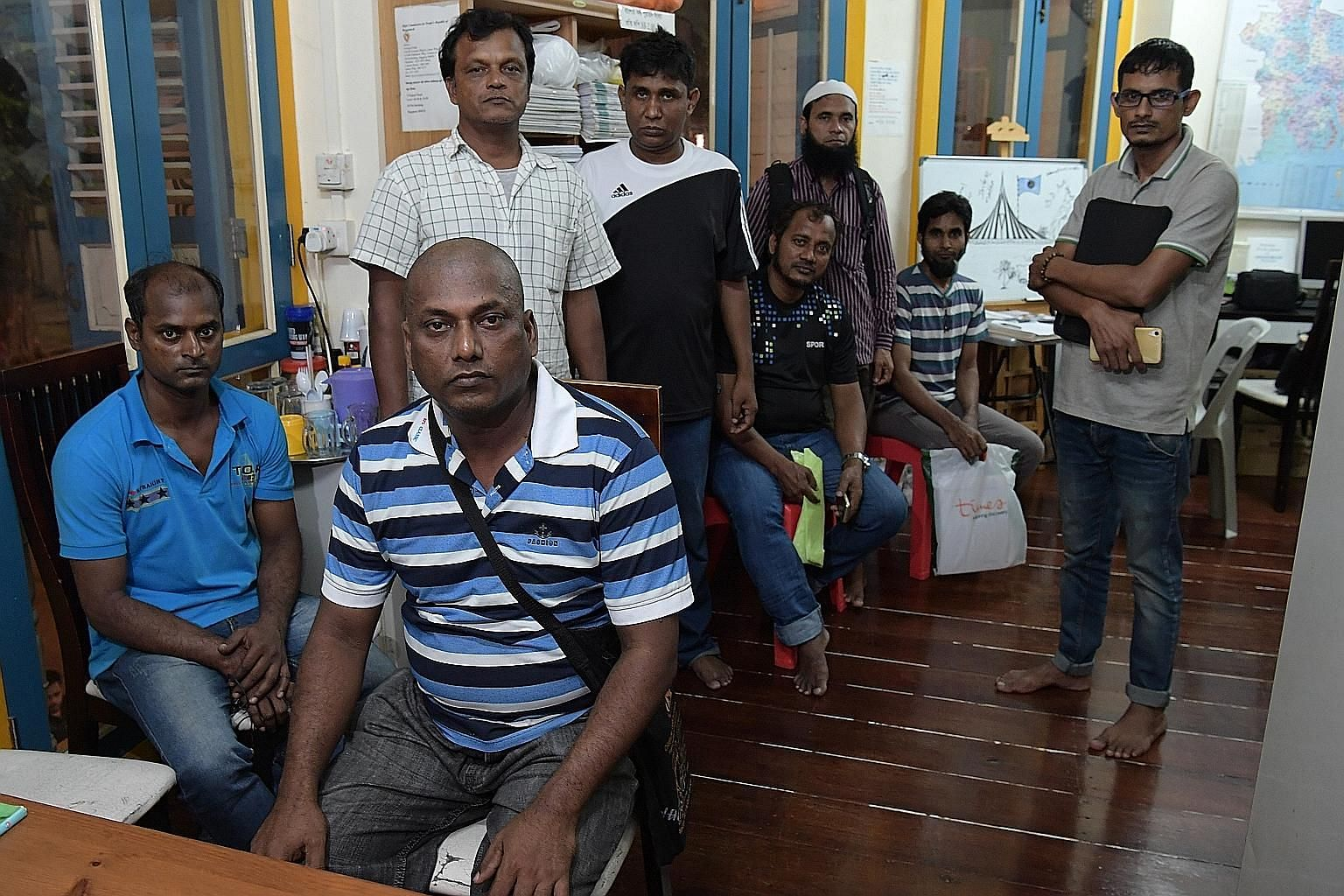 From far left: Mr Amimul, 46; Mr Hasan Mehedi (seated), 46; Mr Saijuddin, 48; Mr Zaman, 46; Mr Kadir, 47; Mr Safiqul, 37; Mr Mohammad Liton, 45; and Mr Monirul Islam, 29. The workers filed their salary claims with the Manpower Ministry earlier this y