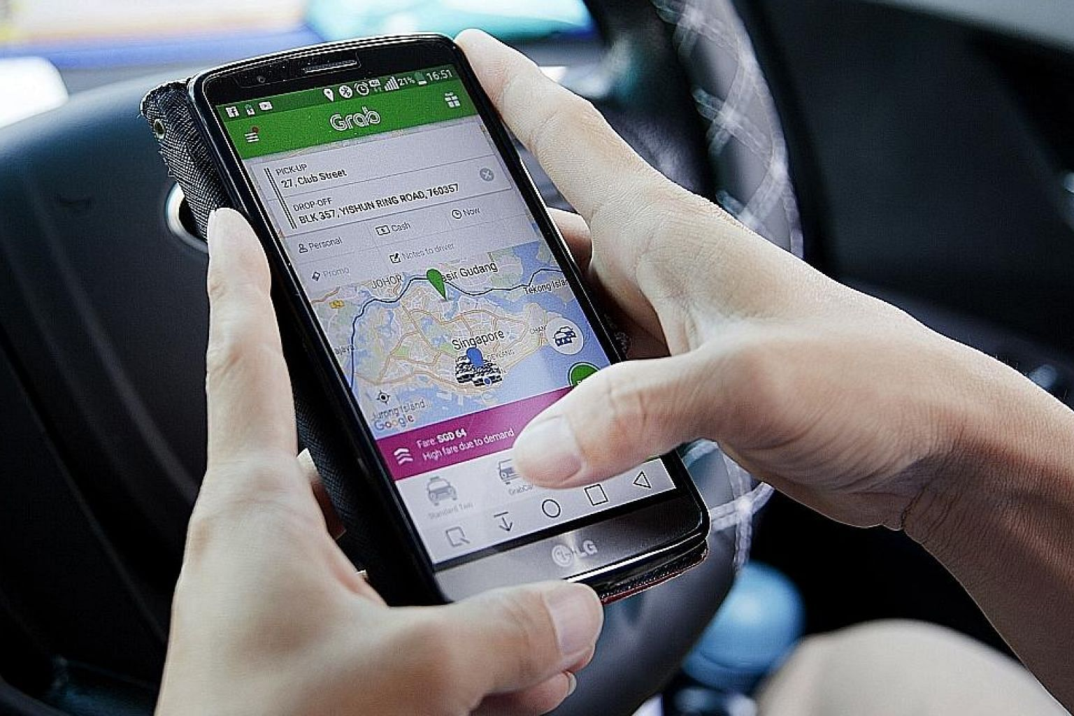A Grab driver uses the Grab app on a smartphone. There are at least 38,000 private-hire car drivers on Singapore roads today, going by the number of private-hire driver vocational licence applications approved by the LTA. Taxi driver Armstrong Ho bel
