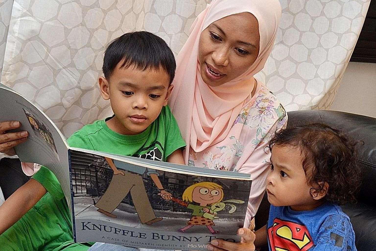 As part of her strategy to teach her sons Adyan Darius Juffrey, six, and Adam Mika Juffrey, three, to read, Ms Shamsiah Samsudin reads their favourite books to them repeatedly.