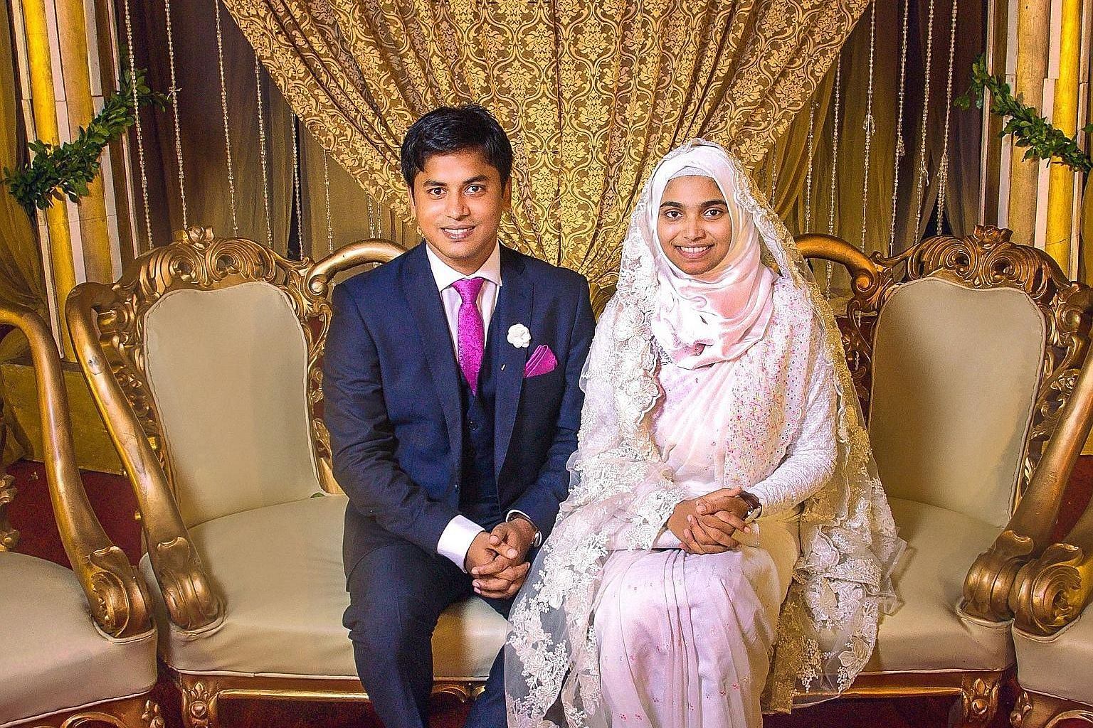 Ms Tasnim Jara and her husband at her wedding in Dhaka. She wore her grandmother's cotton sari with no make-up or jewellery.