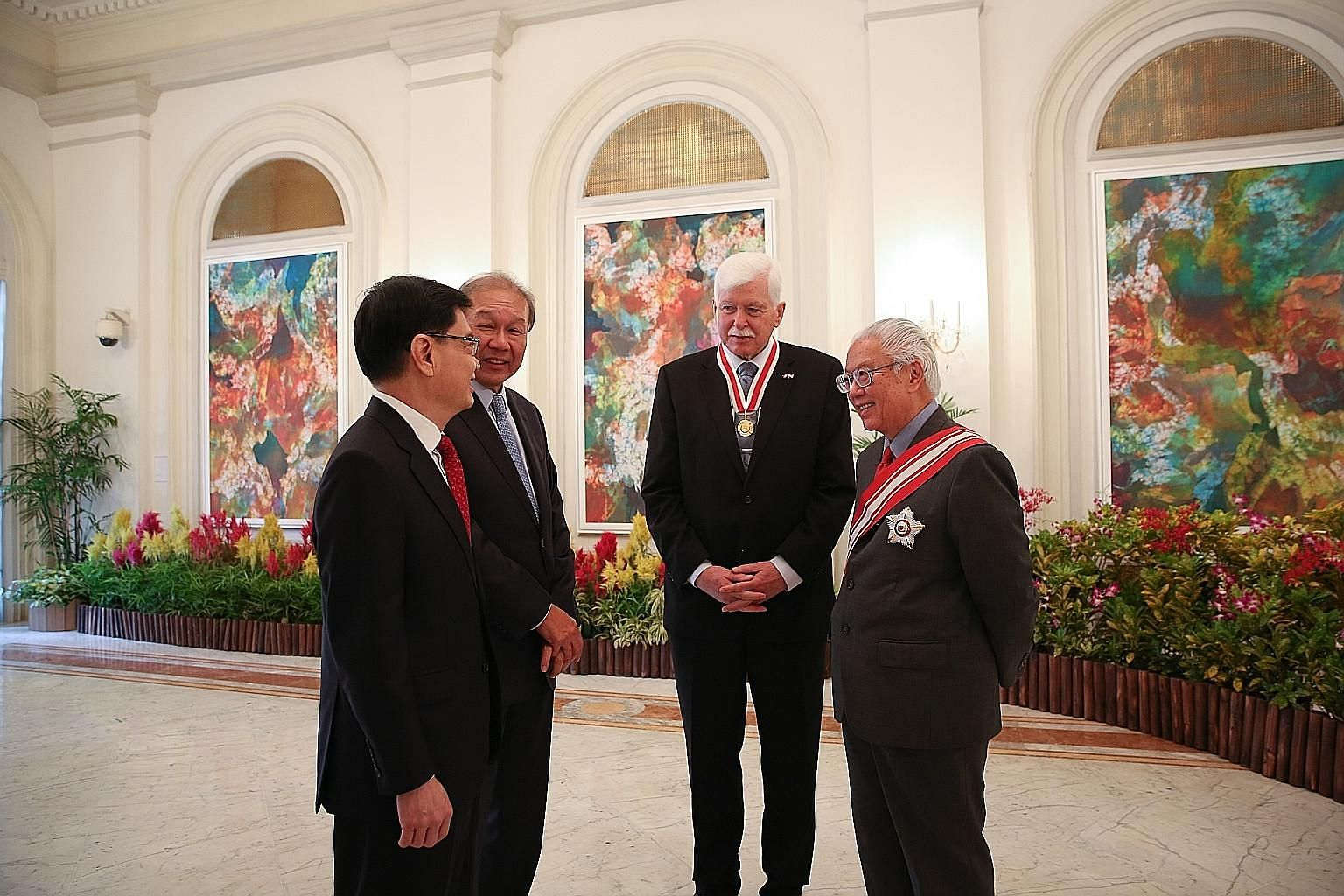 Emeritus Professor Ulrich Werner Suter (second from right) with President Tony Tan Keng Yam, Finance Minister Heng Swee Keat (far left) and NRF chief executive Low Teck Seng at the Istana. The Honorary Citizen Award is the highest form of recognition