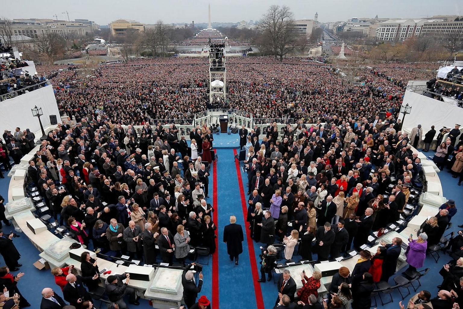 """Former White House press secretary Sean Spicer called the crowds watching Mr Donald Trump's presidential inauguration in January (above) the largest, """"period"""", despite photographs showing otherwise."""