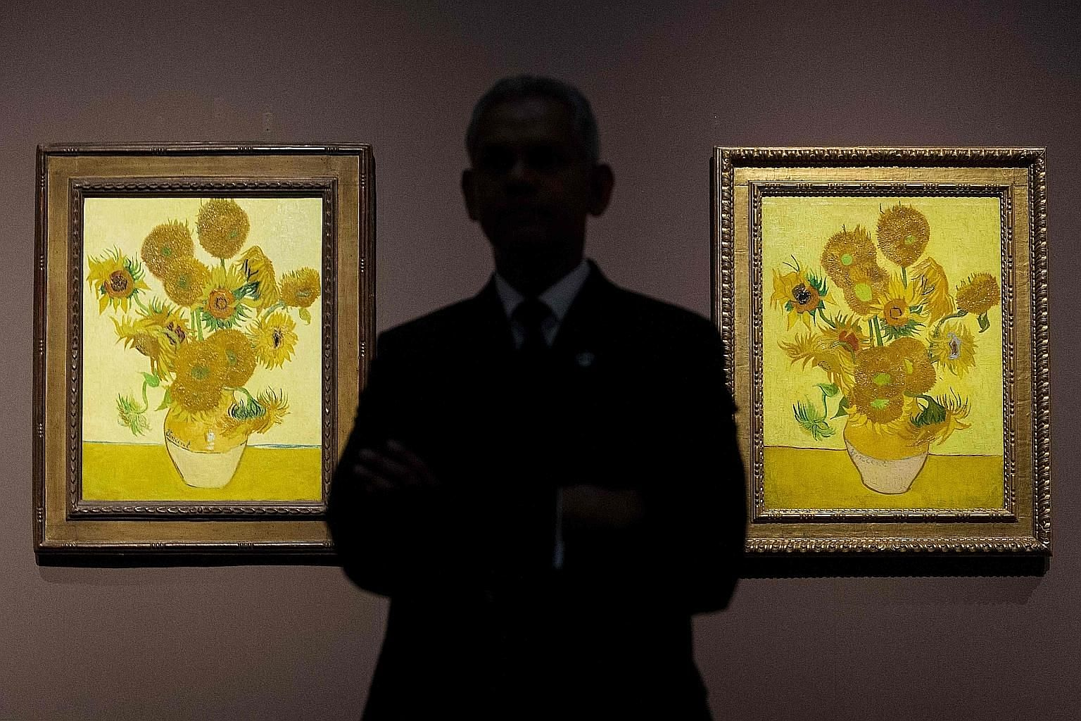 Two versions of Vincent van Gogh's Sunflowers at the National Gallery in London in 2014. The iconic paintings rank among the Dutch master's most famous works.