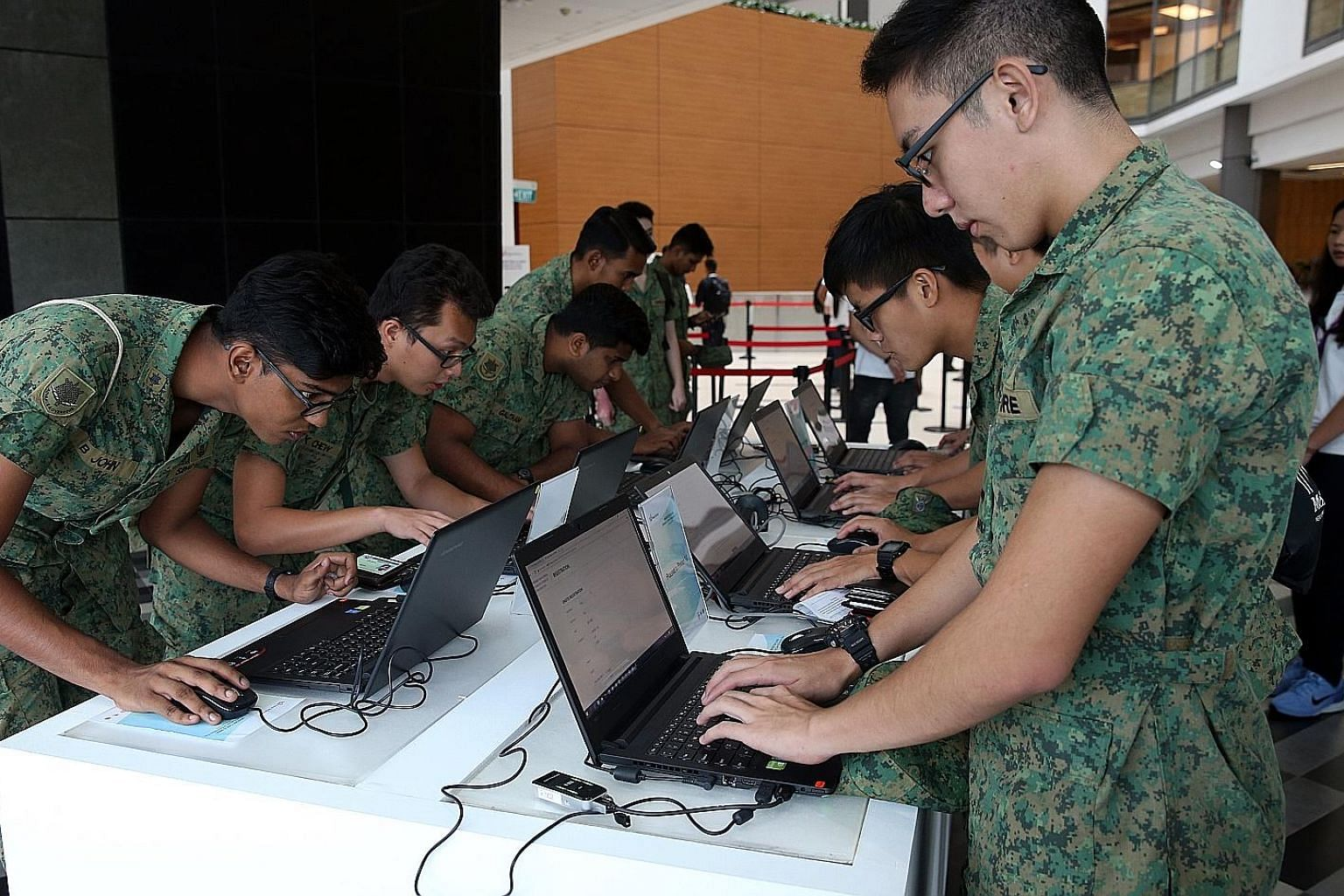 NSFs registering for the Enhanced Career and Education Fair at the Lifelong Learning Institute yesterday. The event was for NSFs about to complete their national service.