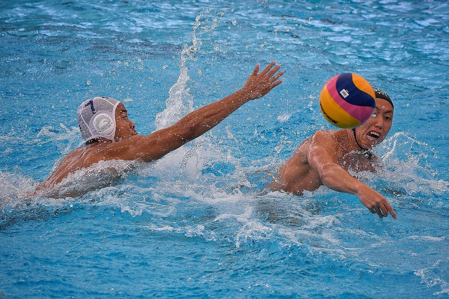 Koh Jian Ying (right) taking a shot during the match against Thailand at the National Aquatic Centre yesterday. Singapore won 13-2.