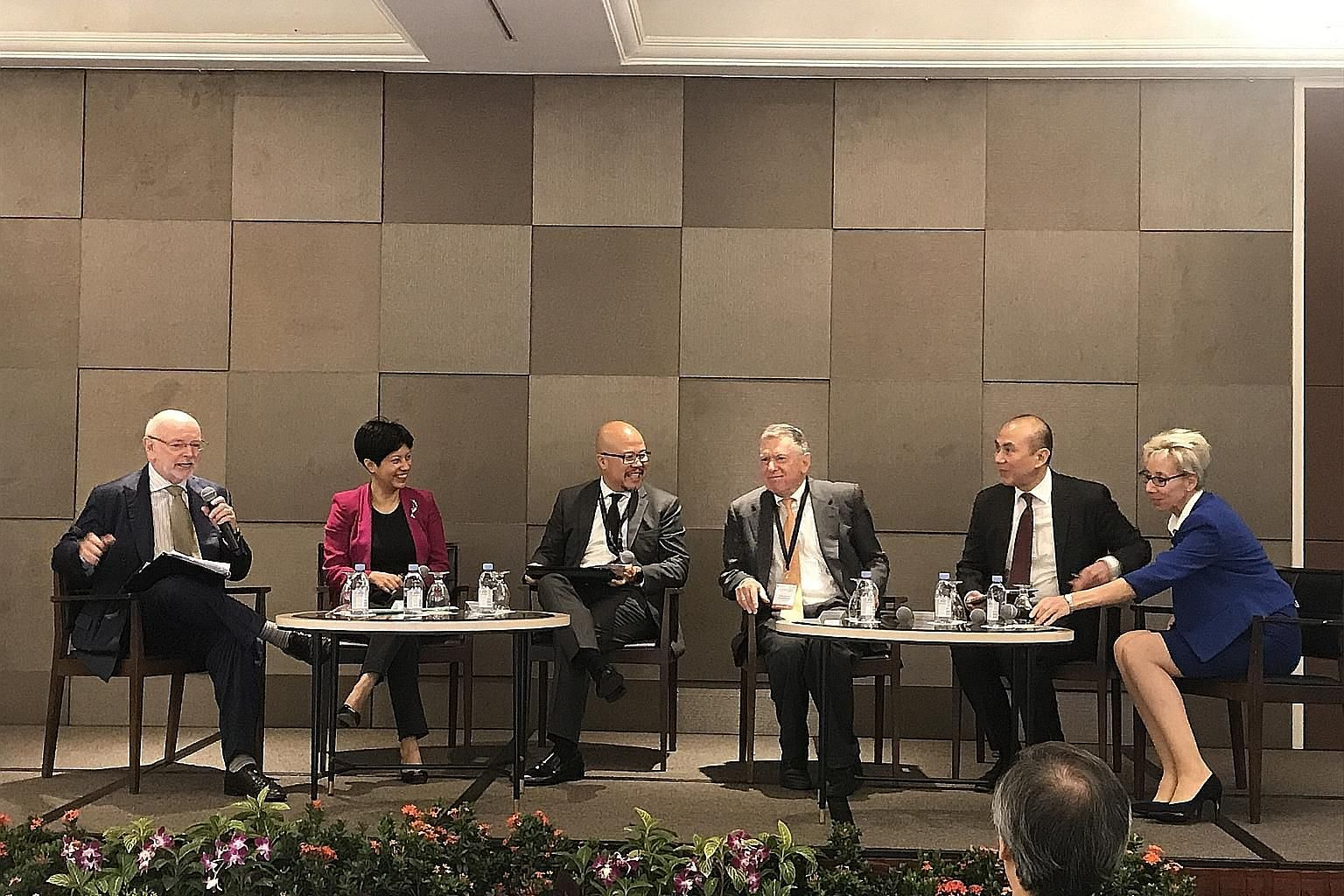 At the SMU-TA Centre for Excellence in Taxation conference yesterday were (from left) Professor Jeffrey Owens, chairman of the centre's technical advisory panel; Ms Indranee Rajah; Mr Chris Woo of PwC Singapore; Prof David Rosenbloom, member of the a