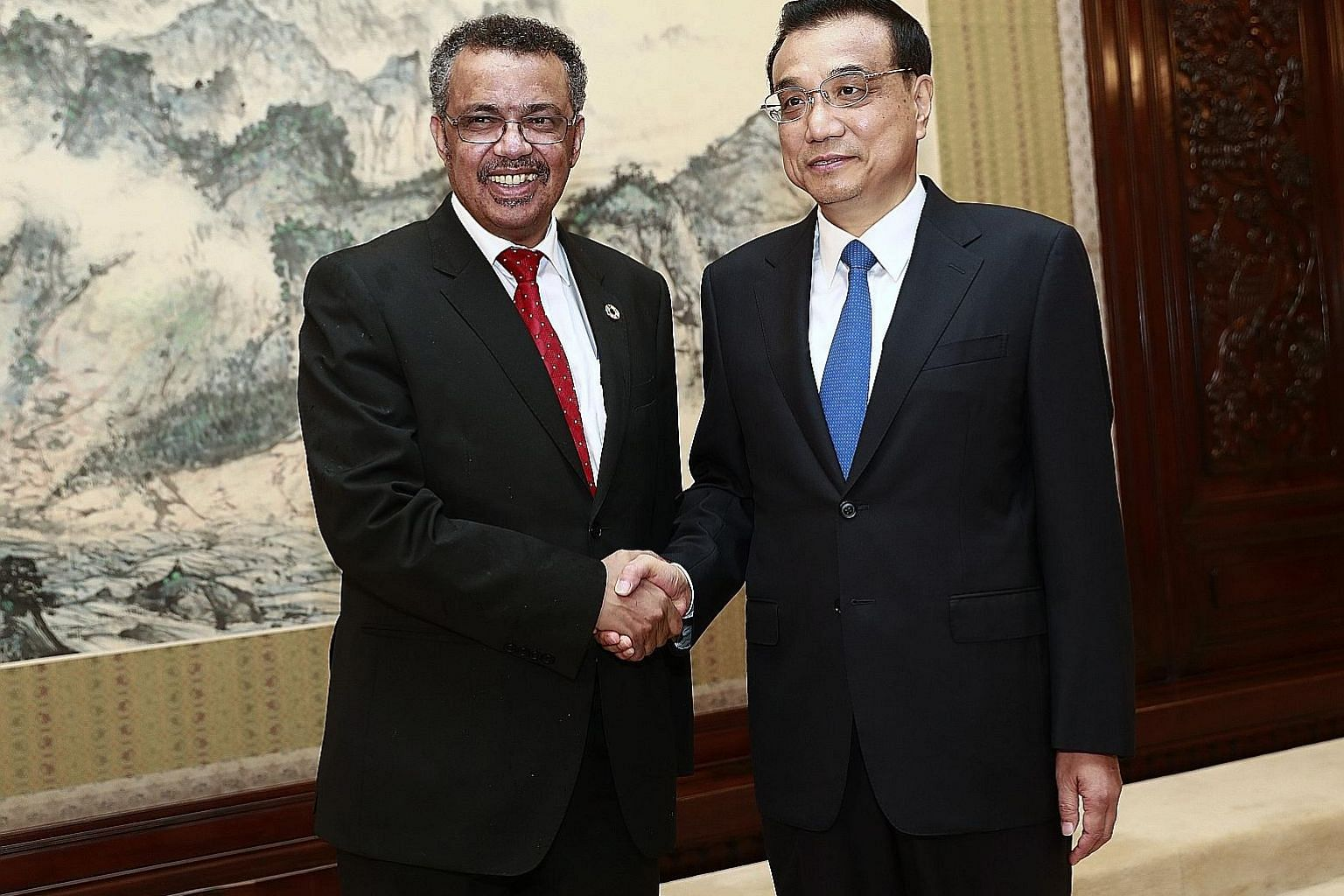 Dr Tedros Adhanom, the director-general of WHO, with Chinese Premier Li Keqiang at a meeting in Beijing yesterday. Dr Adhanom has hailed the Chinese-led health initiative as visionary.