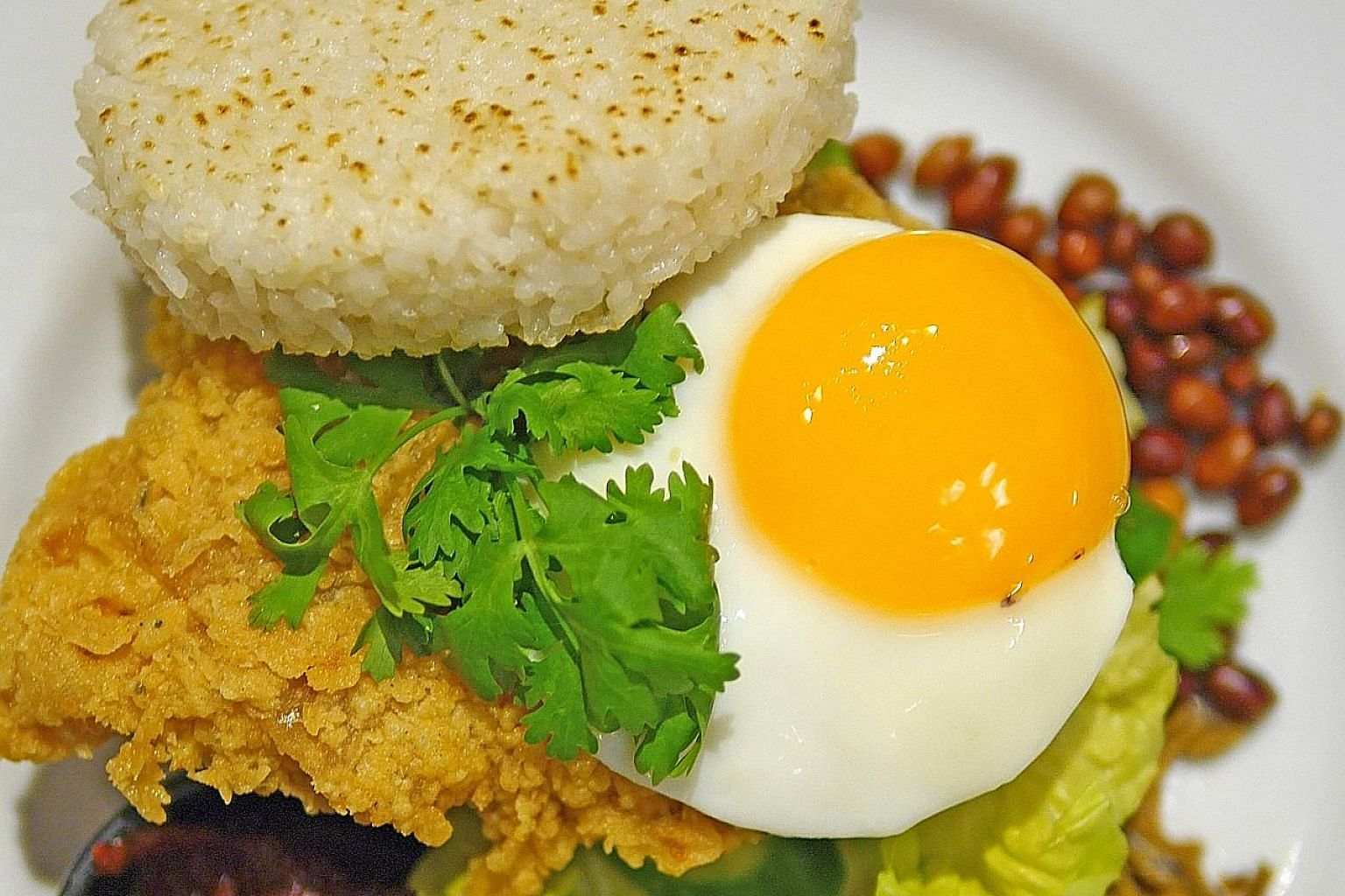 Antoinette's chef-owner Pang Kok Keong challenged himself to create a nasi lemak burger in three days.