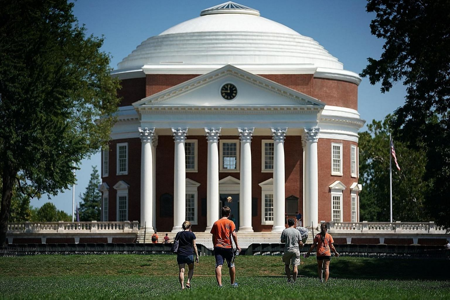 The University of Virginia's revered Lawn, behind which stands the Rotunda. On Aug 12, white supremacists descended on the university to march on the Lawn, and the writer, an alumnus, is proud of the townspeople and students who stood up to defend th
