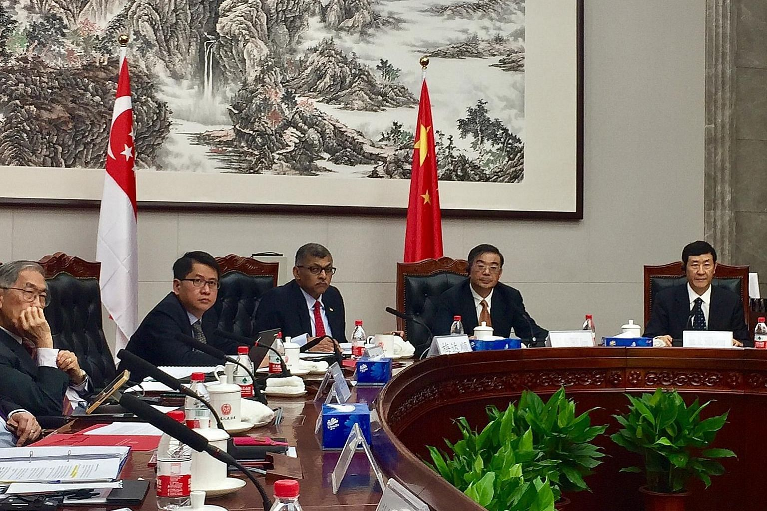 Singapore Chief Justice Sundaresh Menon (third from left) and Chinese Supreme People's Court president Zhou Qiang (fourth from left) at the round-table talk yesterday. With them are (from left) Singapore's Judge of Appeal Chao Hick Tin and Ambassador