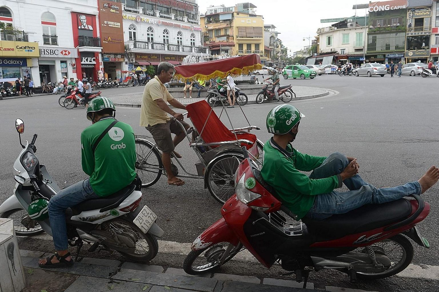 Motorcycle taxi drivers waiting for customers in downtown Hanoi last month. While Vietnam's schools equip students with basic skills for low-wage assembly-line work, its colleges and universities are failing to prepare youth for more complex work.