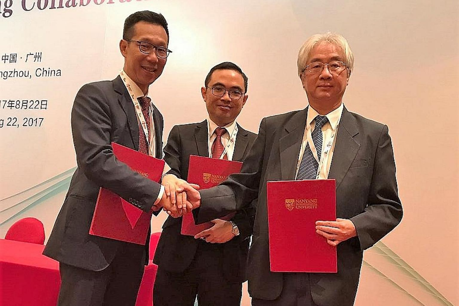 Among those who inked agreements at the eighth Singapore- Guangdong Collaboration Council meeting in Guangzhou yesterday were (from left) TechBridge Ventures' chairman, Dr Lim Jui, and its chief executive, Mr Ho Voon Yee, and Mr Leung Wah Kan, chief