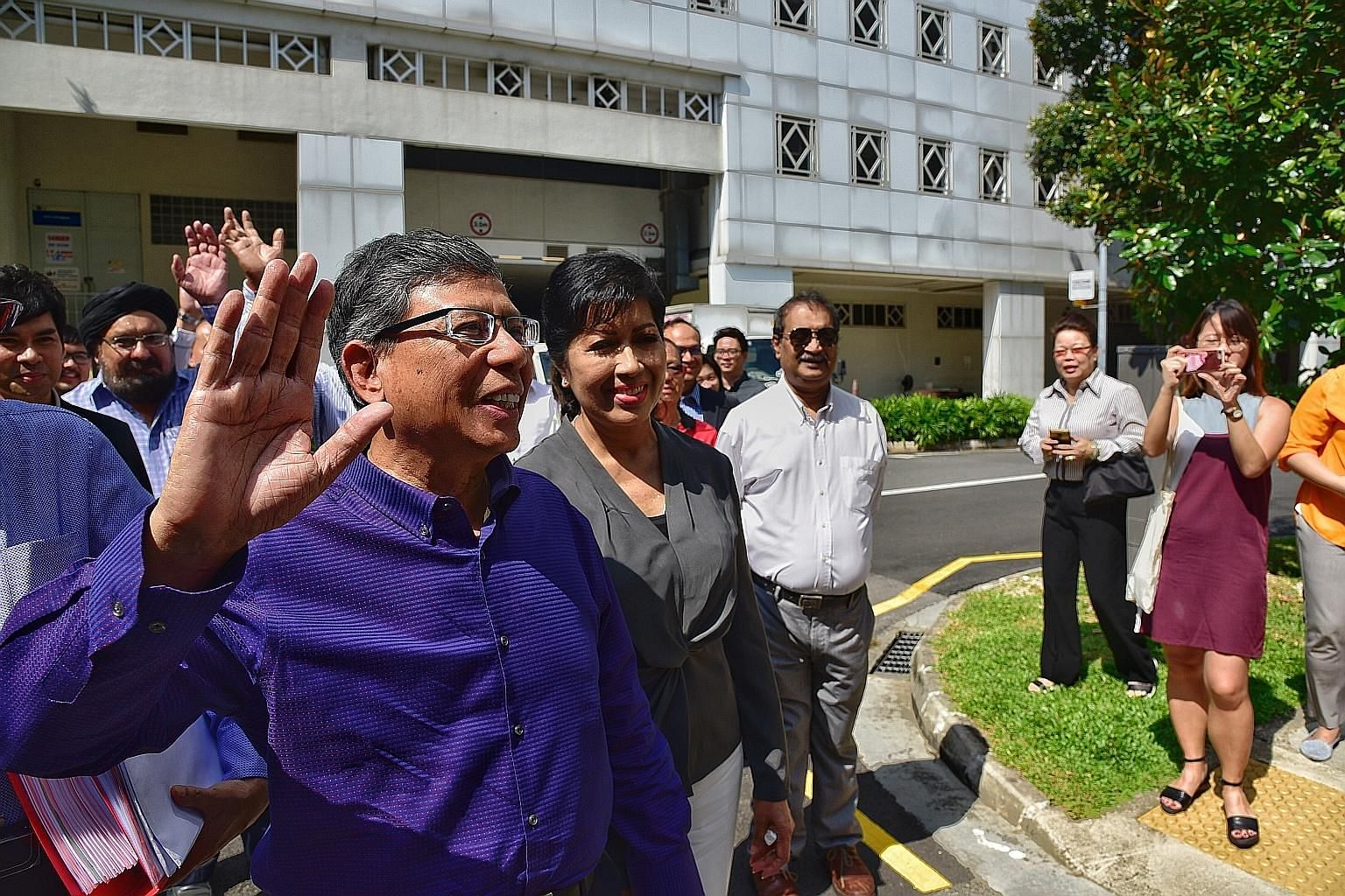 Mr Mohamed Salleh Marican and his wife Sapiyah Abu Bakar at the Elections Department yesterday, accompanied by supporters.