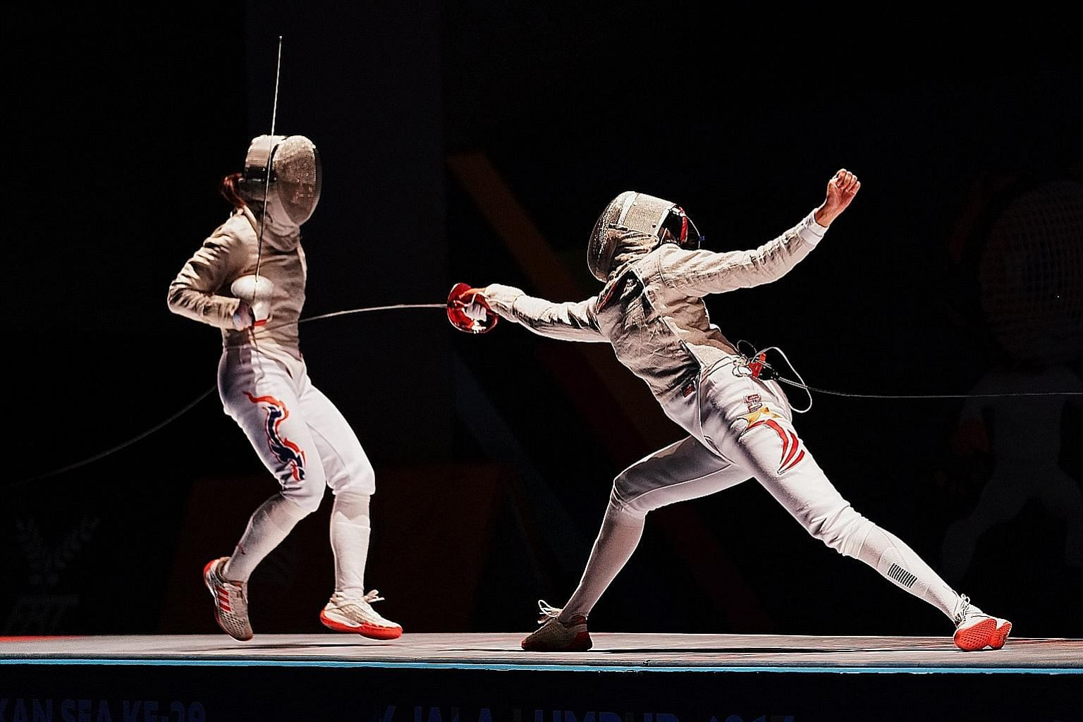 Lau Ywen attacking Thailand's Pornsawan Ngernrungruangroj in the individual sabre final. The reigning Sportsgirl of the Year won 15-12 to clinch her first SEA Games gold medal.