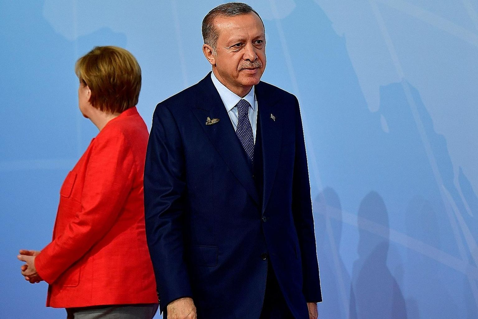 Chancellor Angela Merkel with her back to Mr Recep Tayyip Erdogan at last month's G-20 summit. Bilateral relations reached a nadir after Turkey arrested a journalist of Turkish descent working for a German newspaper.