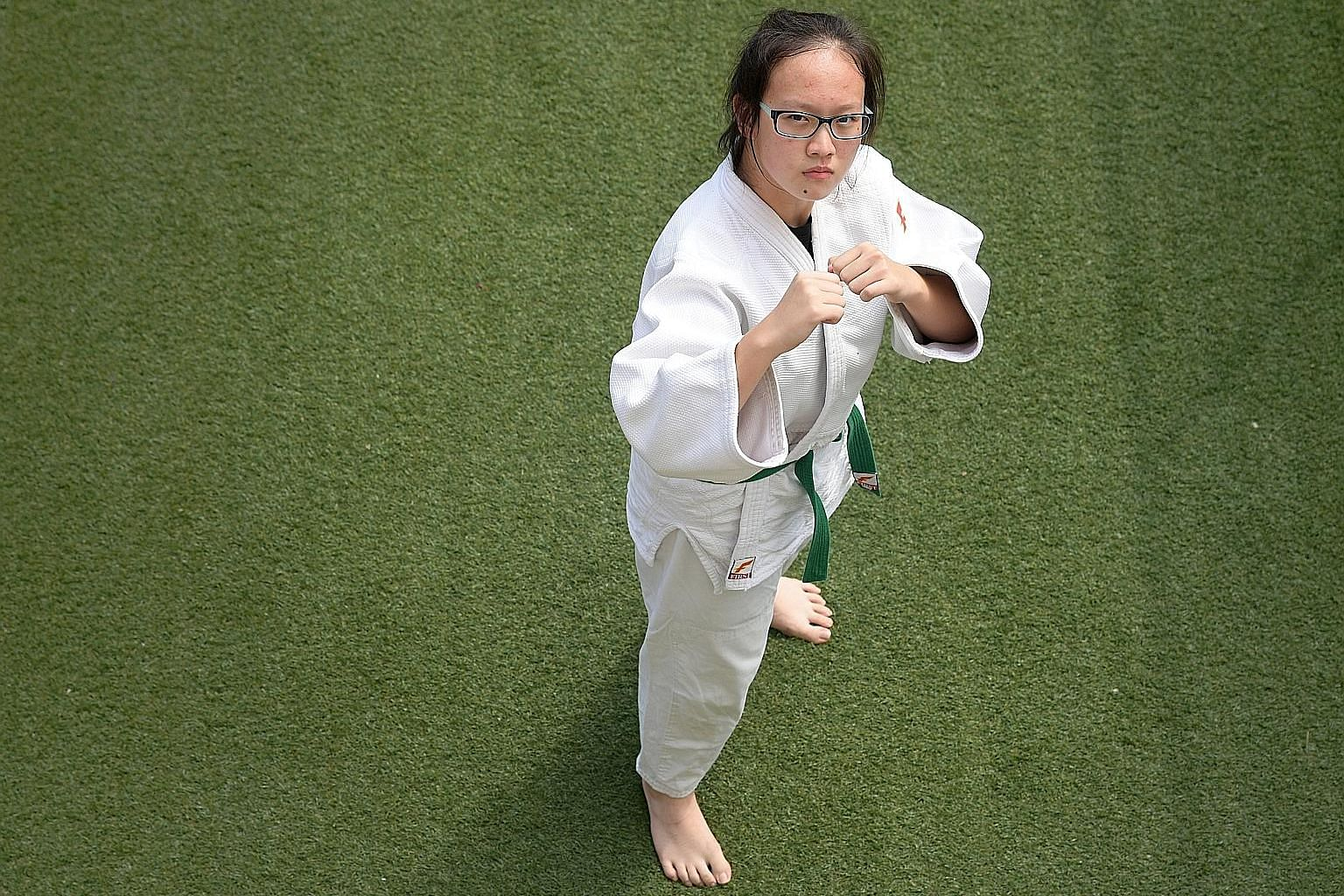 Wang Jinghan put behind her a series of injuries to step back onto the judo mat, all in time to help her school seal the Schools National B Division judo divisional title.