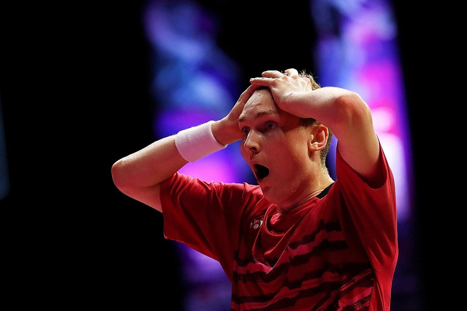 Viktor Axelsen shows his disbelief before sinking to the court after defeating Lin Dan 22-20, 21-16 in the men's singles final of the World Championships in Glasgow on Sunday.