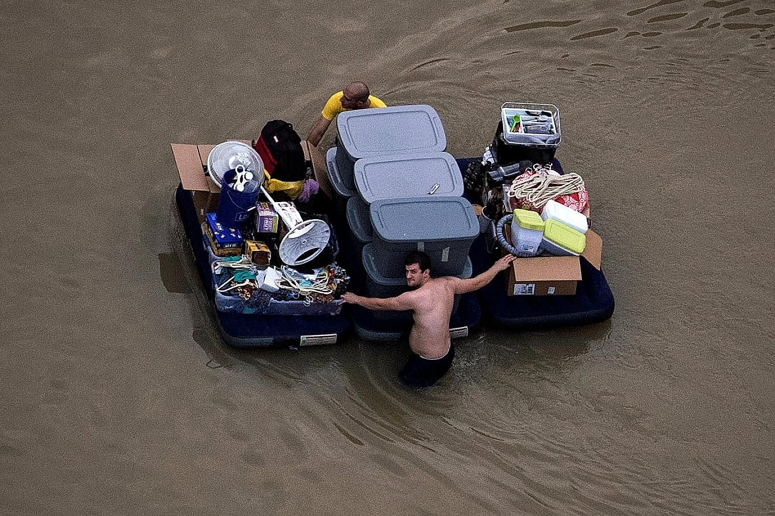 Houston residents trying to salvage their belongings on Wednesday amid record flooding.