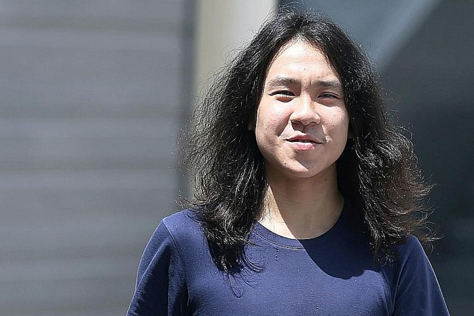 Amos Yee at the State Courts in September last year. Buzzfeed wrote an article on how he fled Singapore at the end of last year to the United States to seek asylum and has been stuck in a detention centre since.