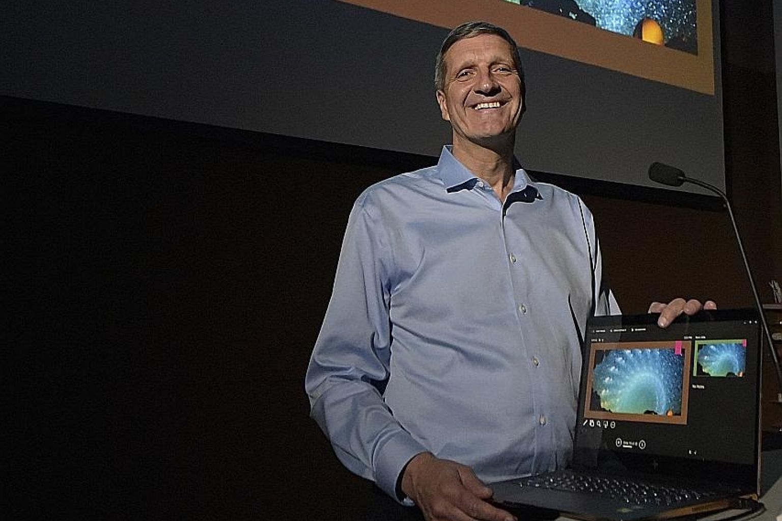 Dr Christian Sasse, whose composite photo of the Milky Way (projected on screen) went viral on social media this year, was in Singapore recently to speak at Visual SG, a visualisation festival.