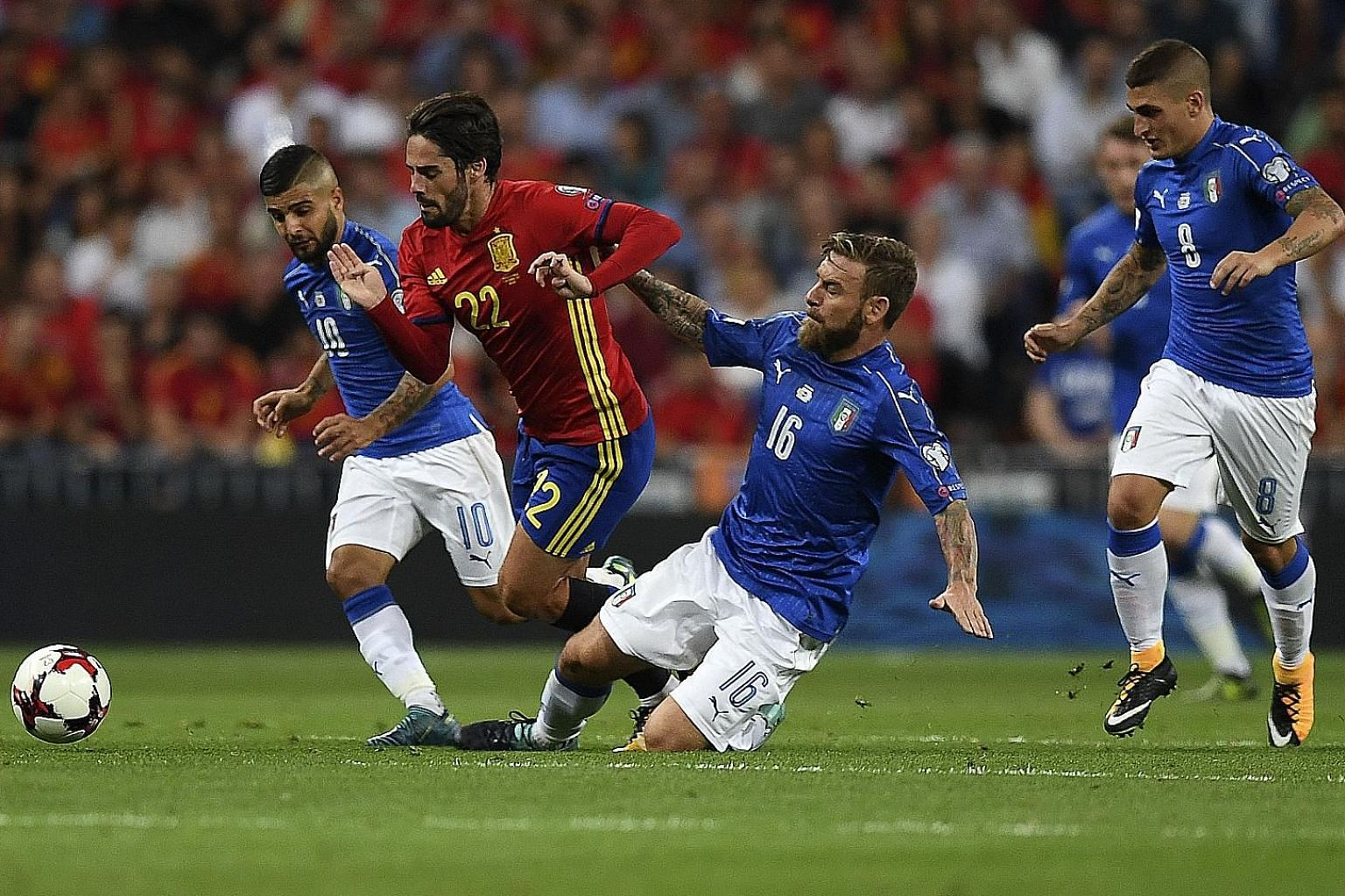 Spain midfielder Isco attempting to get the better of Italy's Lorenzo Insigne (far left) and Daniele de Rossi.